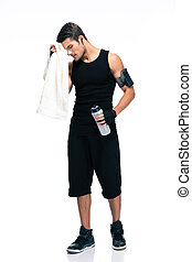 Sports man holding towel and bottle with water