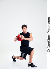 Sports man workout with fitness ball - Full length portrait...