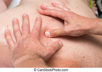Sports massage therapist at work - Massage therapist is...