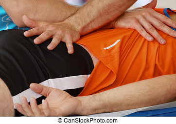 Sports massage therapists work.