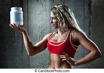 Sports nutrition - Young muscular woman with sports...