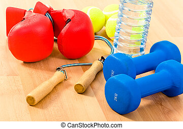Sports objects - Photo of two blue barbells, some tennis ...