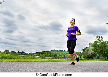 Sports outdoor - young woman running in park - Urban sports...