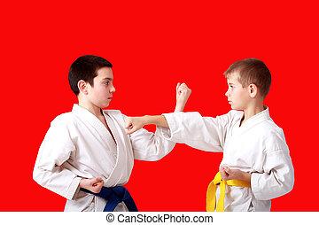 Sports paired exercises karate athletes perform in a kimono