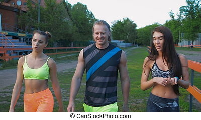 Sports people. The boy and two girls are after your workout...