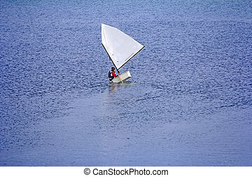 Sports sailing in small boats on the lake