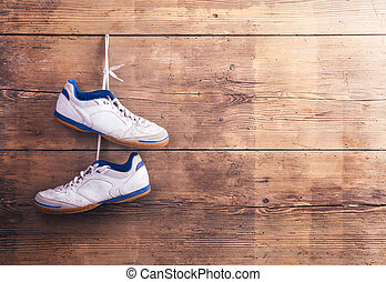 Sports shoes on the floor - Pair of sports shoes hang on a ...