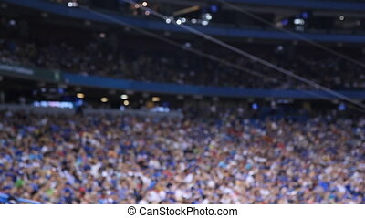 Sports stadium. Defocused. - Crowd at sports stadium. ...
