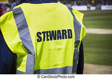 Sports steward by pitch in high viz jacket