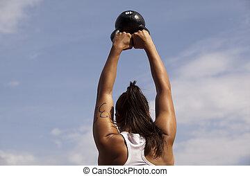 sports training - Woman doing kettlebell workout outside