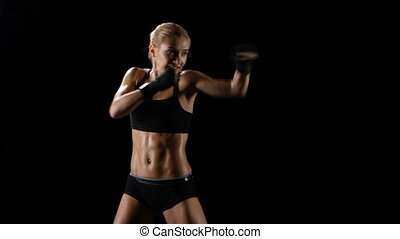 Sports training women boxer. Quick and precise blows -...