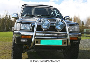 Sports utility vehicle with offroad spot lamps and grill ...