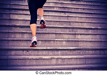 sports woman legs running on stairs