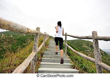 sports woman running on mountain