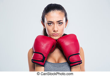 Sports woman standing in defence stance with boxing gloves