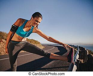 Female athlete getting ready for a run