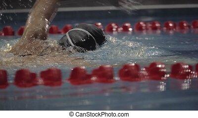 Sports woman swimming crawl stroke in blue waterfloating...