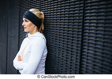 Sports woman taking a break from outdoor training session