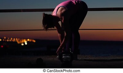Sports Woman Tying Shoe Laces Before Workout