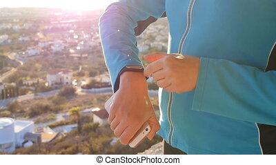 Sports woman using fitness tracker