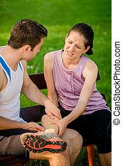 Sports woman with leg injury