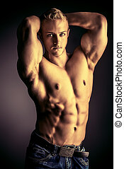 sportsman bodybuilder - Muscular bodybuilder man posing over...