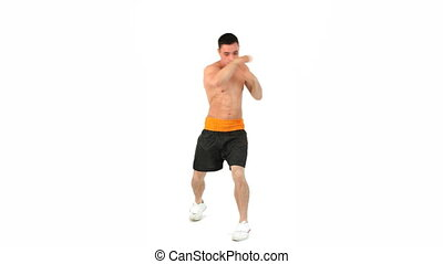 Sportsman boxing against a white background