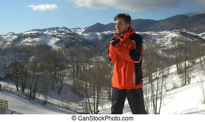 Sportsman freezing outside in a cold winter day at the mountains