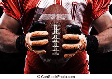 Sportsman holding rugby ball