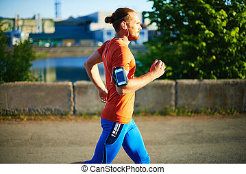 Sportsman jogging - Portrait of young attractive sportsman...