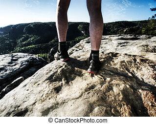 Sportsman on trail. Slim body man in yellow jersey, black shorts