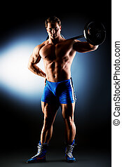 sportsman - Portrait of a handsome bodybuilder posing over...