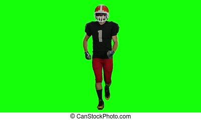 Sportsman running in a helmet and gloves. Front view. Green...