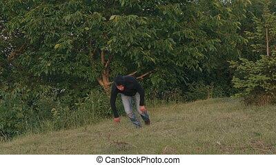 Sportsman running on the grass. Slowly