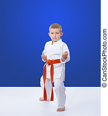 Sportsman stands in the rack of karate
