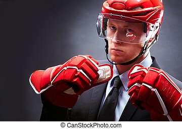 Sportsman - Portrait of sportsman in suit, red gloves and...