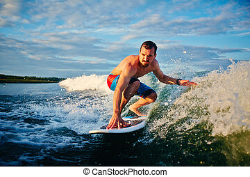 Sportsman surfboarding - Sporty man surfboarding in the sea