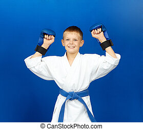 Sportsman with blue overlays on the hands rejoices victory