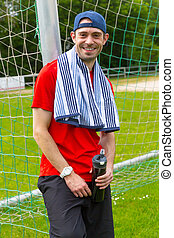 Sportsman with Towel and Bottle