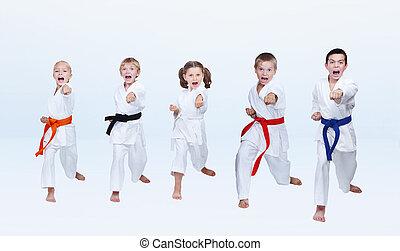 Sportsmen in karategi are beating punch arm