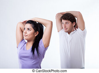 Sportsmen stretching arms