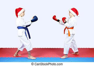 Sportsmens in caps of Santa Claus