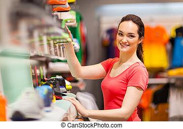 sportswear shop assistant portrait