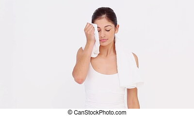Sportswoman drinking water against white background