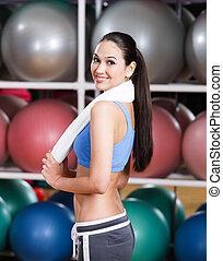 Sportswoman in fitness gym