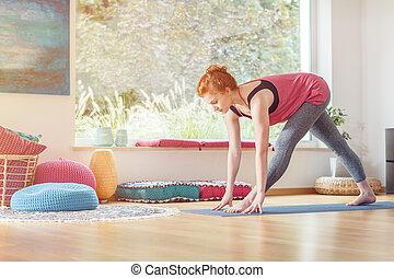 Sportswoman in sportswear stretching