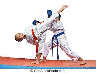 Sportswoman is beating high kick leg to the head an athlete