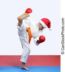 Sportswoman is doing circular kick