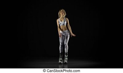 Sportswoman is performing exercises in kangoo jumps shoes at...