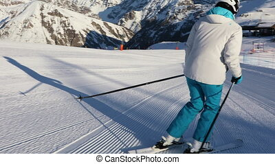 Sportswoman skiing on an empty ski slope - Young adult ...